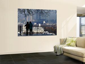Mature Couple Enjoying Winter View of the Maritime Museum and Canary Wharf from Greenwich Park by Doug McKinlay