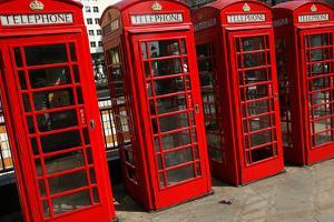 Row of Iconic Red Phone Boxes on the Strand in London by Doug McKinlay