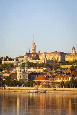Along Danube River Towards Buda Hill and the Martyas Church Illuminated at Sunrise, Budapest by Doug Pearson