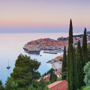 Elevated View over Stari Grad (Old Town) Illuminated at Sunrise, Dubrovnik, Dalmatia, Croatia by Doug Pearson