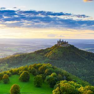 Hohenzollern Castle and Sourrounding Countryside Illuminated at Sunset, Swabia, Baden Wuerttemberg by Doug Pearson