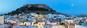 Lindos Acropolis and Rooftop Restaurants Illuminated at Dusk, Lindos, Rhodes, Greece by Doug Pearson