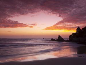 Sunset over Surfers, Biarritz, Pyrenees Atlantiques, Aquitaine, France by Doug Pearson