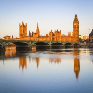 The Houses of Parliament and the River Thames Illuminated at Sunrise. by Doug Pearson
