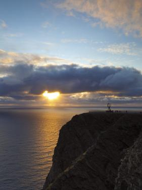 The Midnight Sun Breaks Through the Clouds at Nordkapp, Finnmark, Norway by Doug Pearson