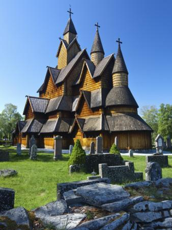 Tourists Checking Map Beside Heddal Stave Church, Norway's Largest Wooden Stavekirke by Doug Pearson