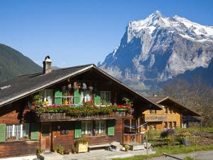 Traditional Houses, Wetterhorn and Grindelwald, Berner Oberland, Switzerland by Doug Pearson