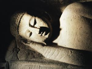Detail of Stone Carving of the Buddha, Ellora Caves, Maharashtra State, India by Doug Traverso