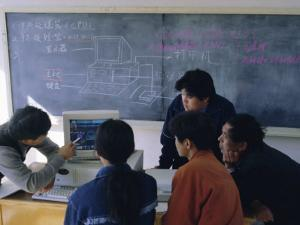 Students at a Computer Demonstration in a Class at a Rural School, China by Doug Traverso