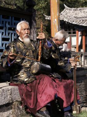 The Naxi Orchestra Pracisting by the Black Dragon Pool, Lijiang, Yunnan Province, China by Doug Traverso