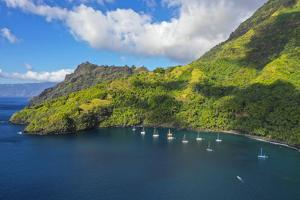 Cruising yachts anchored. Hapatoni, Tahuata, Marquesas, French Polynesia, South Pacific. by Douglas Peebles
