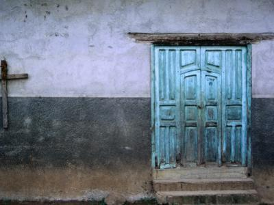 Blue Door and Cross on Wall