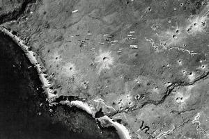 Dozens of Bombs Fall from a U.S. Bomber Toward Japanese-Occupied Kiska Island