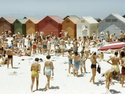 Afrikaners Relax on a Sunny, Cabana-Lined Beach