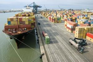 Container Ship And Port by Dr. Juerg Alean