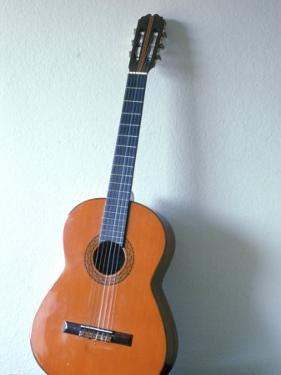 Guitar Leaning Against a Wall by Dr. Luis De La Maza