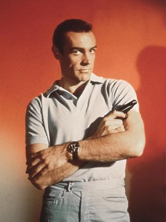 https://imgc.allpostersimages.com/img/posters/dr-no-by-terence-young-with-sean-connery-1962-photo_u-L-Q1C3WUF0.jpg?artPerspective=n