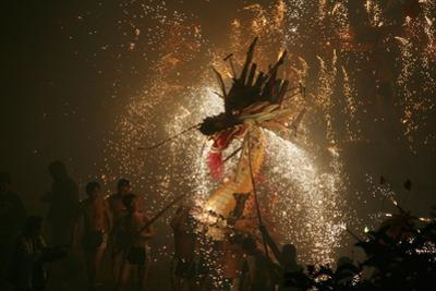 Dragon dance with fireworks during Spring Festival, Hong Kong, China