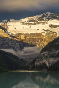Snow Covered Mountains Reflected on Lake Louise in Banff National Park by Drew Rush