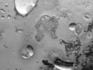 Droplets of Water on Gray Mottled Steel Surface