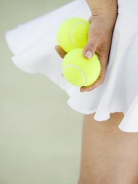 Woman Holding Tennis Balls by Duane Osborn