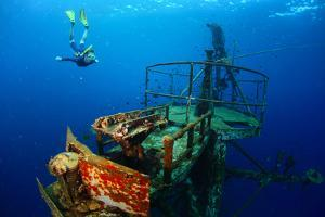 Free Diver Exploring the Ship Wreck in Tropical Clear Sea by Dudarev Mikhail