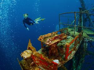 Free Diver Exploring the Ship Wreck in Tropical Sea by Dudarev Mikhail