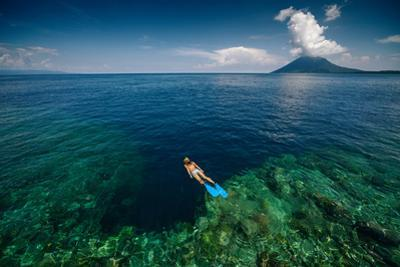 Young Lady Snorkeling over the Reef Wall in the Area of the Island of Bunaken, Sulawesi, Indonesia by Dudarev Mikhail