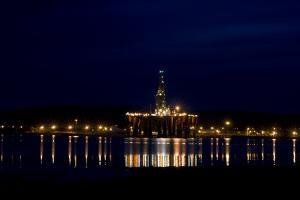 Oil Drilling Rig At Night, North Sea by Duncan Shaw