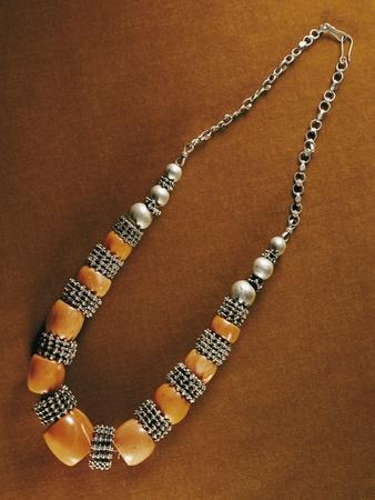 https://imgc.allpostersimages.com/img/posters/duqaq-necklace-composed-of-elements-in-macro-granular-wrought-silver-and-pacific-coral-yemen_u-L-POPQLJ0.jpg?p=0