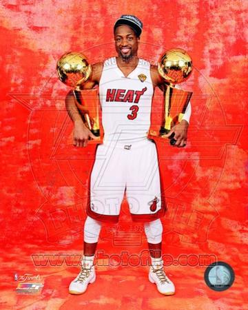 Dwyane Wade with his two NBA Championship Trophies Game 5 of the 2012 NBA Finals