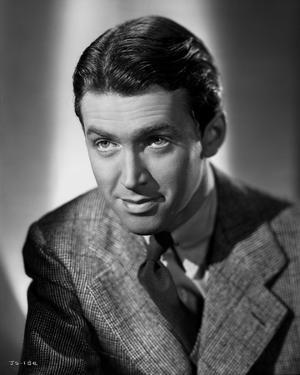 James Stewart Posed in Grey Corduroy Suit and Black Silk Necktie with Eyes Looking Up by E Bachrach