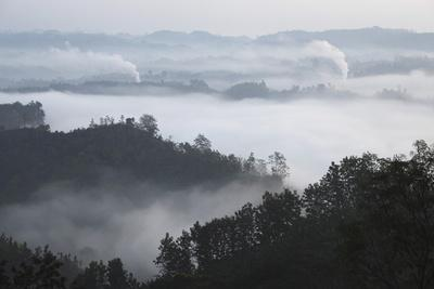https://imgc.allpostersimages.com/img/posters/early-morning-mist-and-smoke-from-brickworks-in-the-valley-over-the-jungle-of-bandarban_u-L-PQ8T6Z0.jpg?p=0