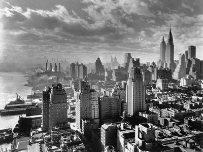 https://imgc.allpostersimages.com/img/posters/east-river-waterfront-and-manhattan-1931_u-L-PZLV9V0.jpg?p=0