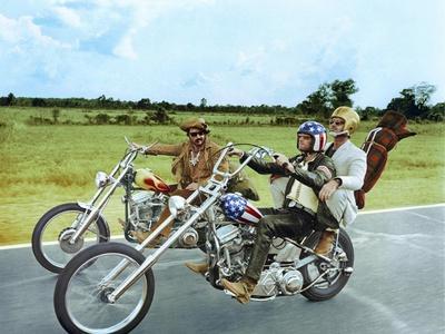 https://imgc.allpostersimages.com/img/posters/easy-rider-by-dennishopper-with-dennis-hopper-peter-fonda-and-jack-nickolson-1969-motos-harley-d_u-L-Q1C45SZ0.jpg?artPerspective=n