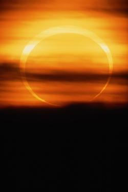 Eclipsed Sun Setting