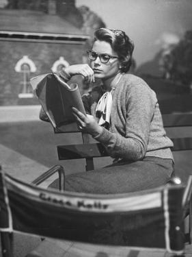 "Actress Grace Kelly Studying Script for Her Role of Georgie in ""The Country Girl"" on movie set by Ed Clark"