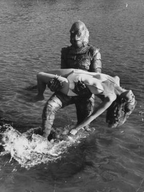 Actress Julia Adams is Carried by Monster, Gill Man, in the Movie, Creature from the Black Lagoon by Ed Clark