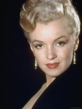 Actress Marilyn Monroe Wearing Dangling Rhinestone Earrings, with Her Hair Up by Ed Clark