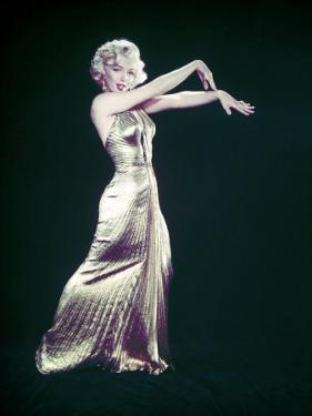 """Actress Marilyn Monroe Wearing Gold Gown Designed by Bill Travilla for """"Gentlemen Prefer Blondes"""" by Ed Clark"""
