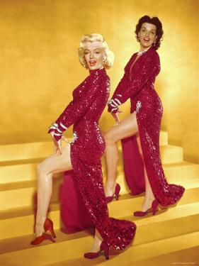 Actresses Marilyn Monroe and Jane Russell Wearing Gowns Designed by Travilla Pose for Publicity by Ed Clark