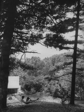 Billy Graham Reading the Bible Outside the Cabin Where He Seeks Seclusion by Ed Clark