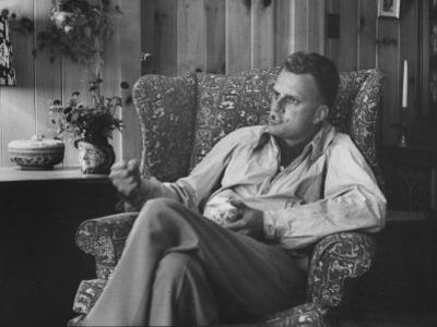 Evangelist, Billy Graham, Sitting in Easy Chair, Talking, in His Home by Ed Clark