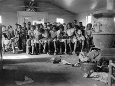 Large Group of Mostly African American Students in a Ramshackle One Room Schoolhouse by Ed Clark