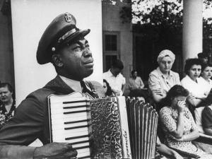 Navy CPO Graham Jackson Playing Accordian, Crying as Franklin D Roosevelt's Body is Carried Away by Ed Clark