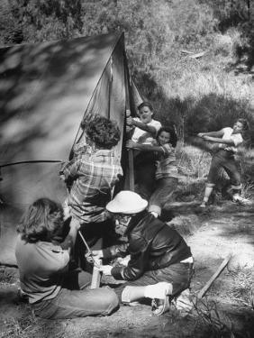 Putting Up a Tent, Some Junior High Girl Scouts Working Toward Camp Craft Badge by Ed Clark