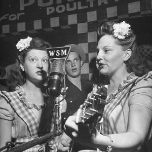 Sisters Performing at the Microphone at the Grand Ole Opry by Ed Clark