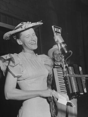 Woman Performing Onstage at the Grand Ole Opry by Ed Clark