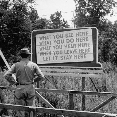 WWII Era Billboard at Oak Ridge Facility Warn Workers to Keep silent of anything seen or Heard here
