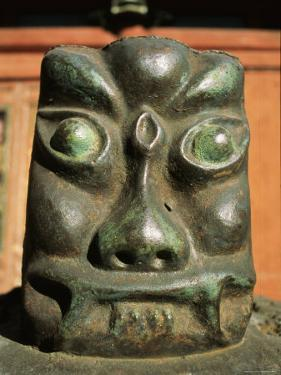 A Carving of a Face in the Bogdo Khan Palace Museum, Mongolia by Ed George